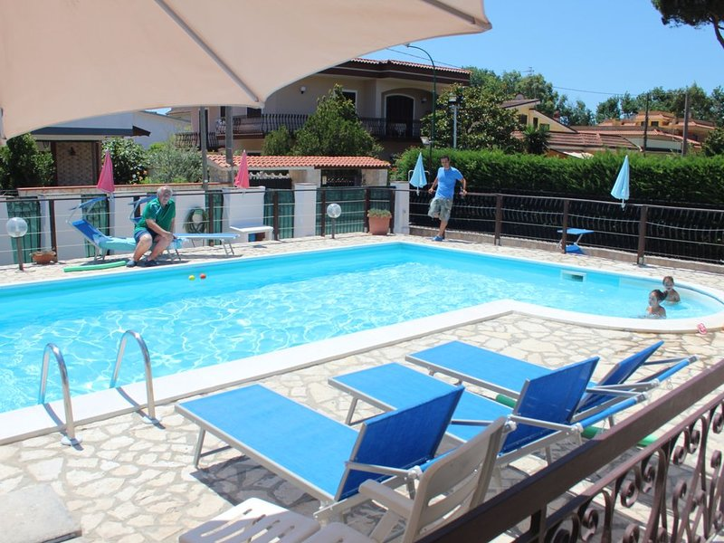 private pool, deckchairs