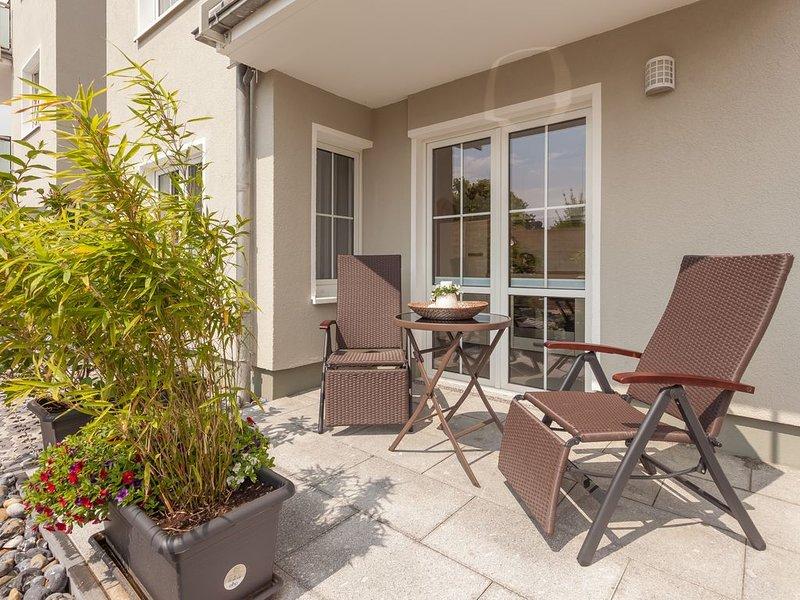 Villa Manatee, Wohlfühl-Appartement mit Terrasse & Saunabereich in Sellin, holiday rental in Sellin
