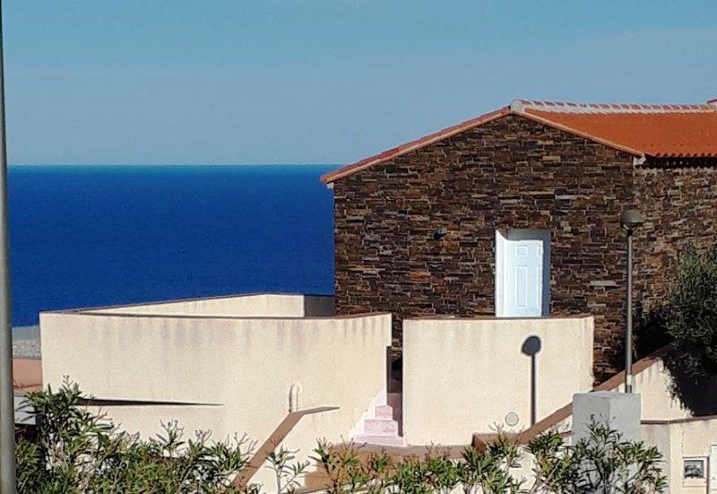 Het huis en terras gegarandeerd zeezicht