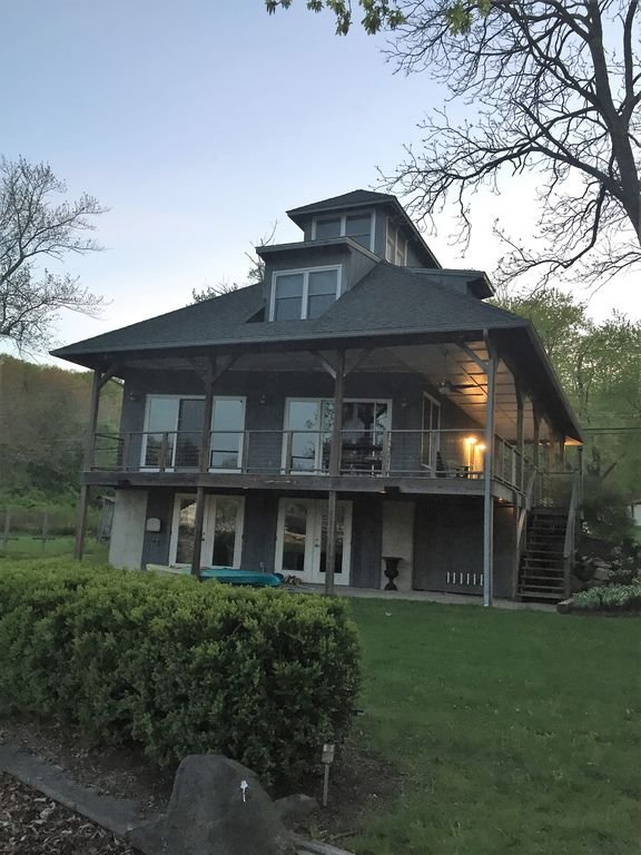 Front of house from lake at dusk