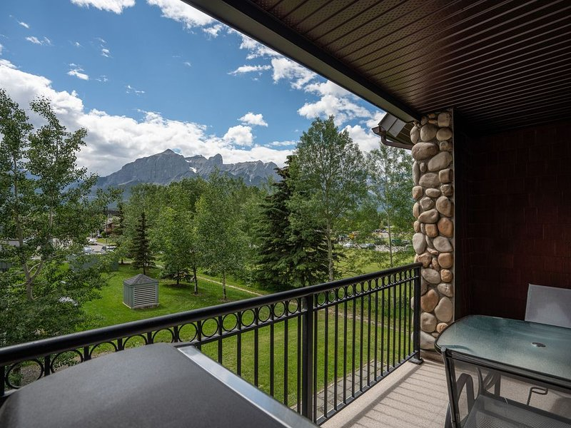 Soak in the stunning mountain views and fresh air while relaxing on the balcony