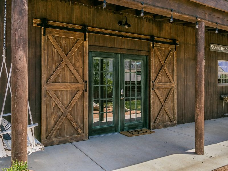 French doors entering barn with barn doors on top