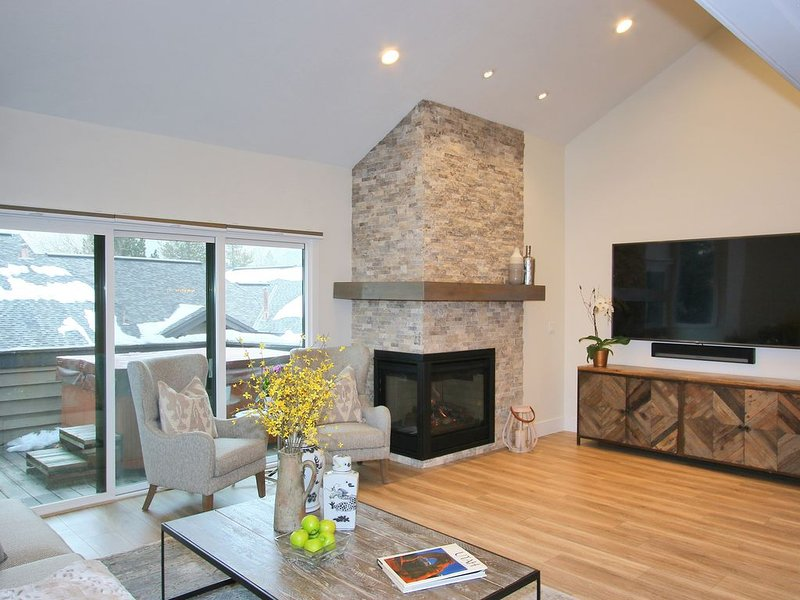 Family room with 75 inch flat screen (apple TV,cable) and gas fire place