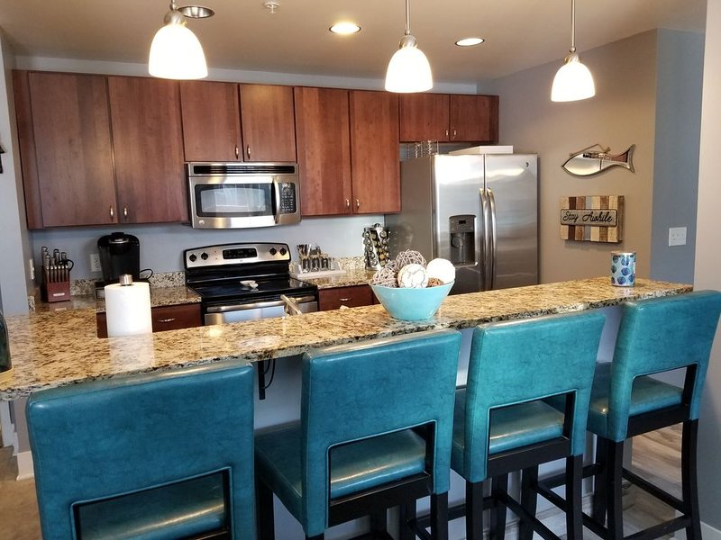 Beautiful condo in the heart of Grand Haven, MI. 1/2 mile to the waterfront, alquiler vacacional en Grand Haven