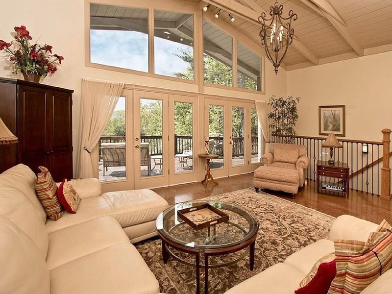 Grand living room with ample seating and views