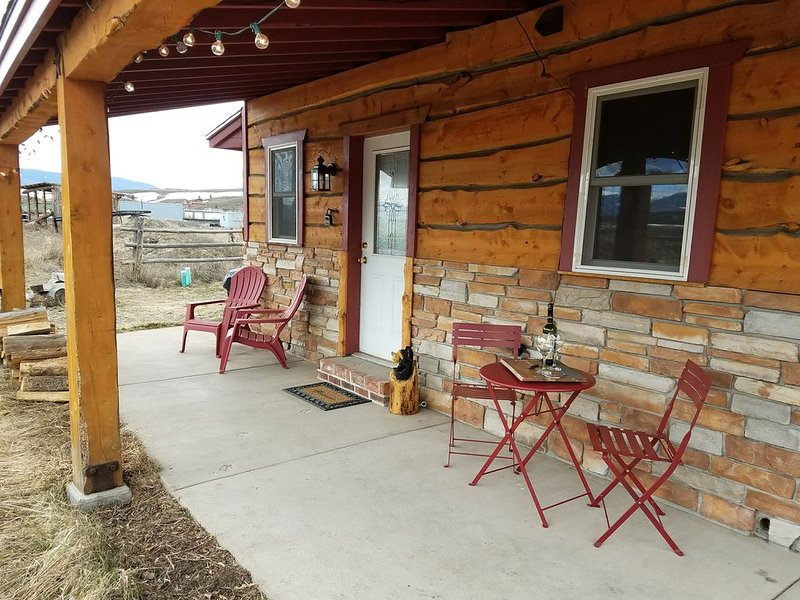 Inviting porch to welcome you to your holiday or just relax with a beverage.