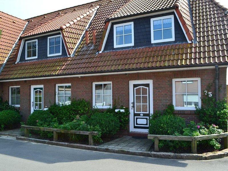 Landhaus am Deich Wohnung Möwe, location de vacances à Vollerwiek