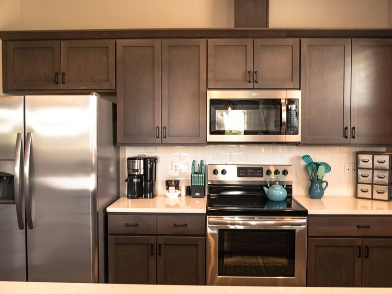 cozy fully furnished kitchen with stainless appliances