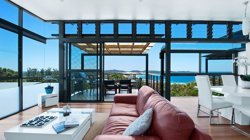 Stunning coastal views from open plan living and balcony