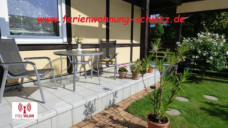 Your terrace facing south with sofa and 2 chairs