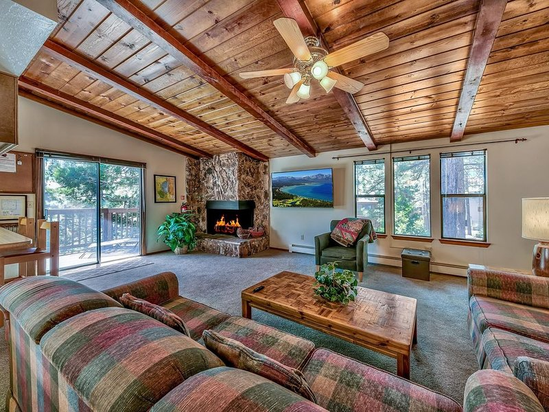 Beautiful living area with deck access and filtered lake views!