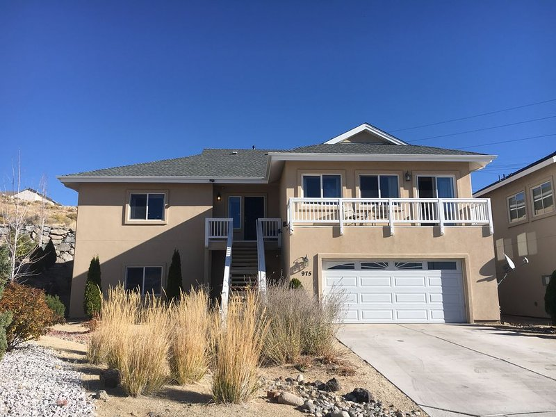 Two story 4 bedroom 3.5 bath home with upstairs living overlooking Reno.