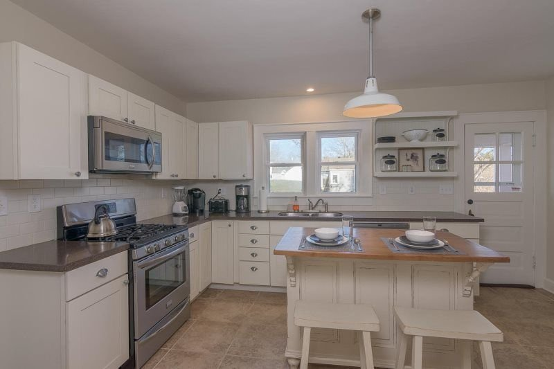 Walk to town from this Brick Cape Cod Traditional, holiday rental in Balsam Grove