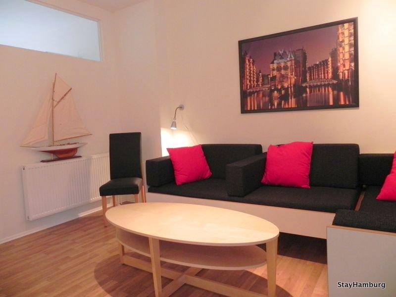 Sala de estar con 2 sofás cama adicionales.