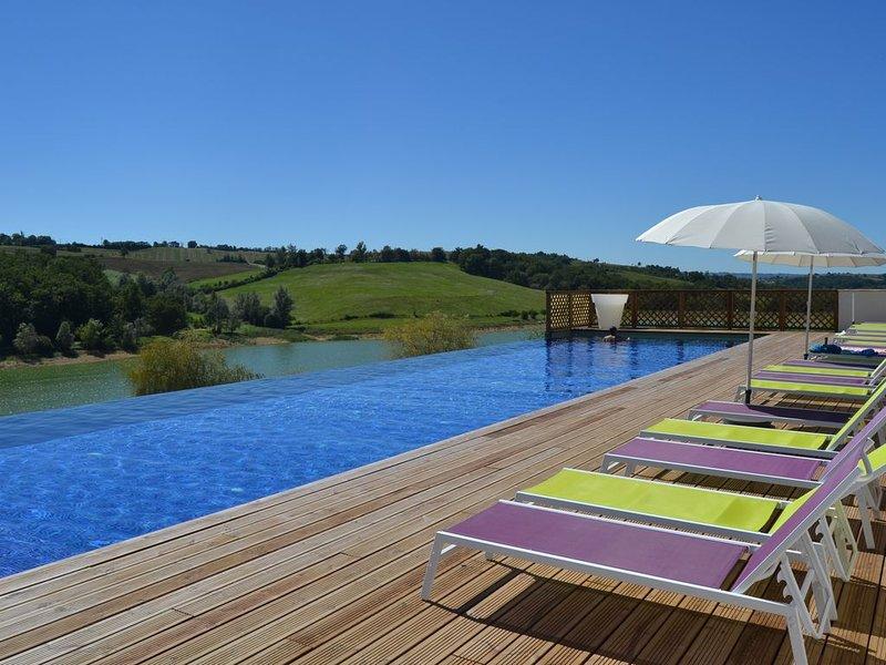 Maison de vacances *** - 2 chambres - piscines chauffées, location de vacances à Artigat
