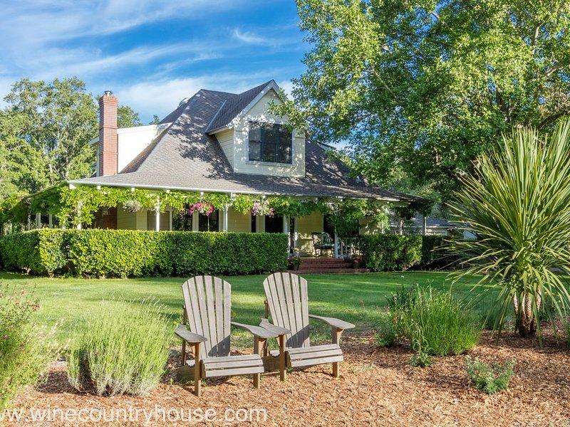 Distinctive farmhouse with wraparound veranda set on nearly four private acres