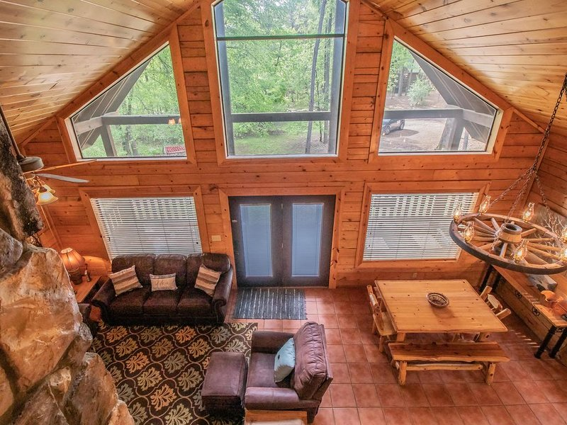 The natural light and beauty of the forest come pouring into the home