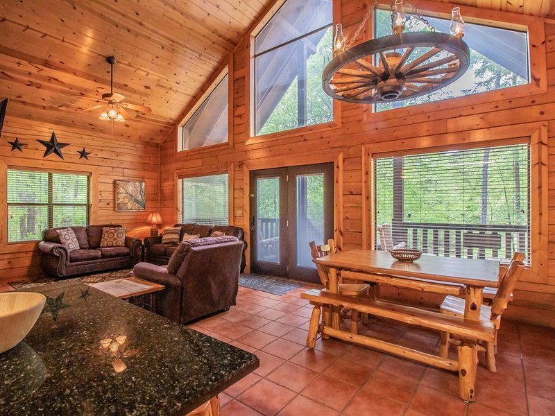 Huge Open Concept Living with floor to ceiling windows and wrap around deck.