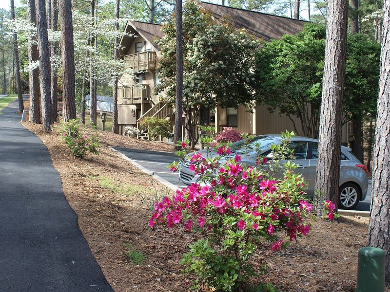 Paved walking path is steps from the door and leads to The Club and beyond.