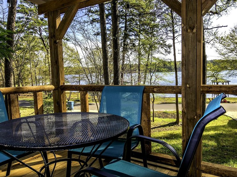 Enjoy a meal or drinks on the front deck with views of beautiful Lake Hawkins!