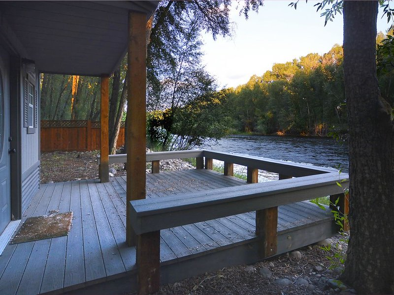 Sit for hours on the porch of the Hideaway Cabin and listen to the river.