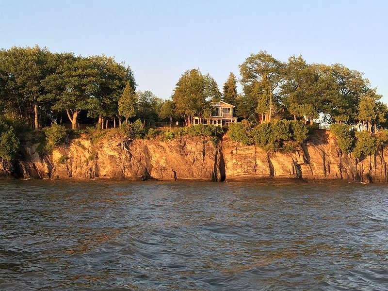 View of the Camp at Barney Point from Lake Champlain at dusk...