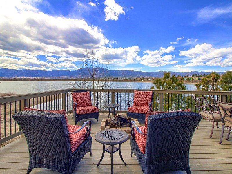 Deck overlooking Woodmoor Lake with gas fire pit.