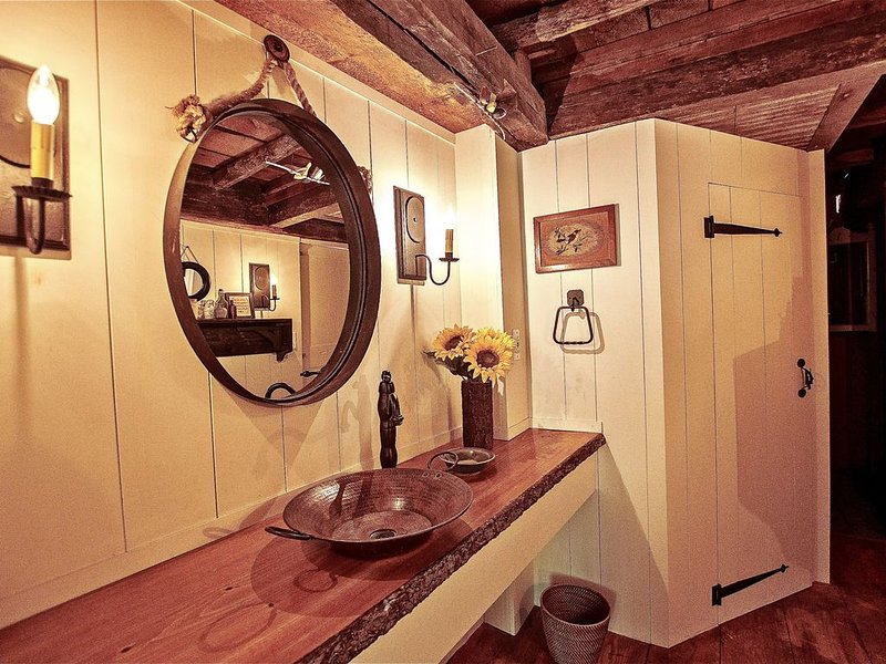 Between the Tudor queen room and napping room, the tree trunk bathroom