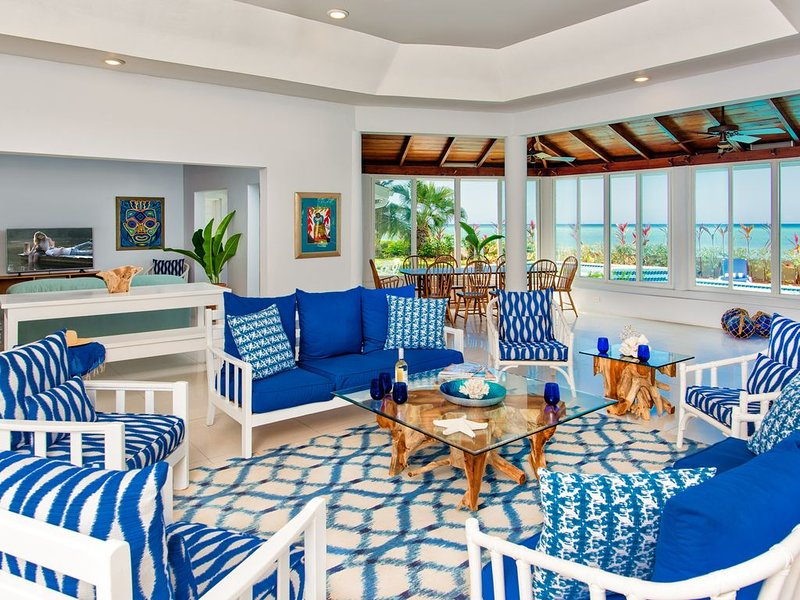 Spacious open living/dining/TV areas fronted by Caribbean Sea