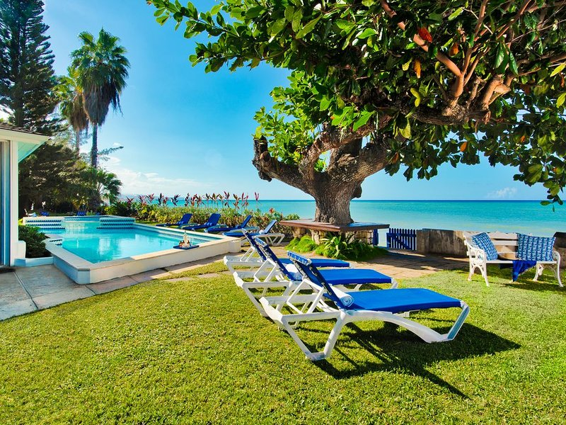 Sun kissed lounging by pool in front garden with magnificent ocean views