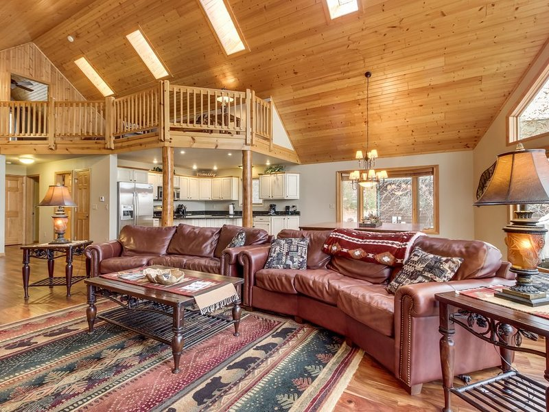 Lakefront home w/ private dock, beach, firepit, playground, deck & game room!, vacation rental in Eagle River