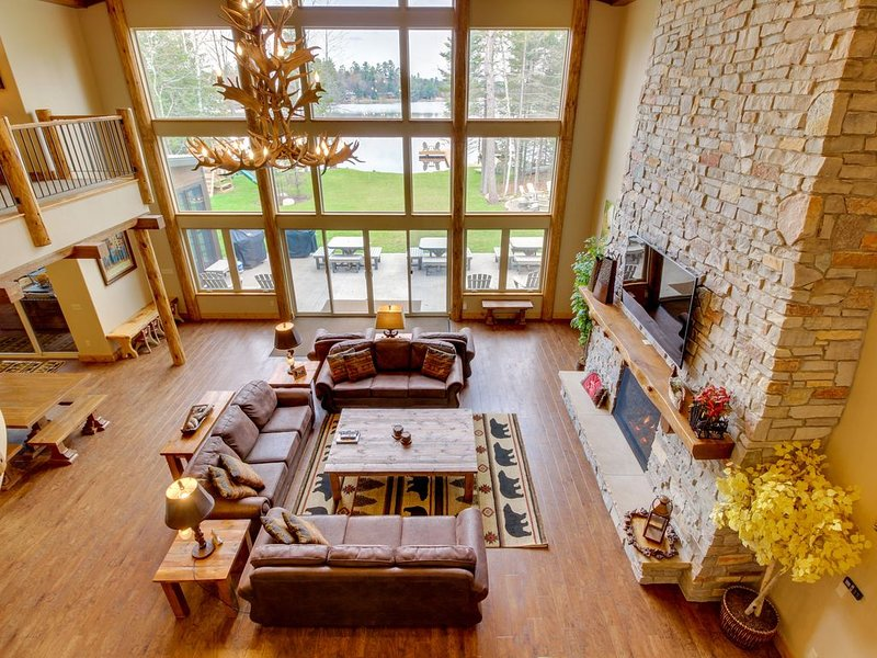 Luxury lakefront home w/dock, beach, bar & theater room, vacation rental in Eagle River