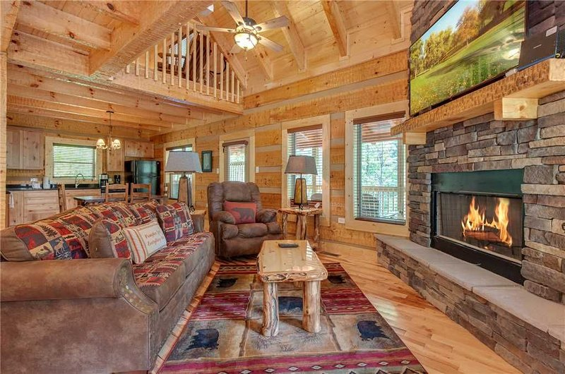 The Perfect Smoky Mountain Hideaway - Snuggle in front of the warm fireplace, and watch a movie on the 42' TV! However you choose to unwind in Lovers' Hideaway, you'll do so in lavish comfort.