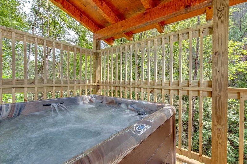 Luxuriate In The Hot Tub - The jets of steamy water are sure to relax your muscles after a day spent exploring the Great Smoky Mountains!