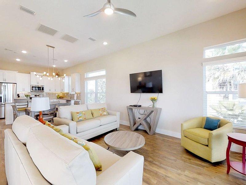 Stylish, brand new ocean view home w/deck & porch - steps to beach, location de vacances à Palm Coast