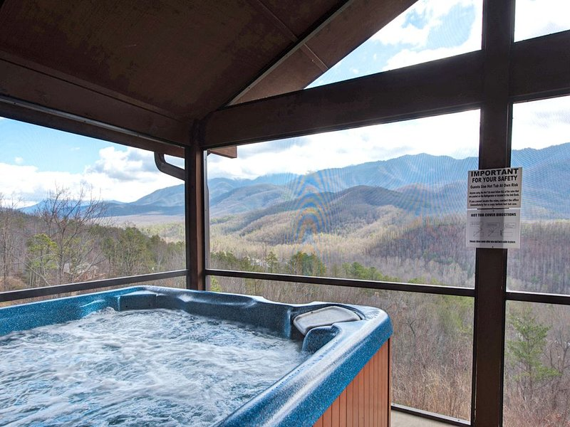 This is the life - The hot tub is nestled in a screened-in portion of the deck, so that you can relish the glorious view of the Great Smoky Mountains without being distracted by the buzzing of pesky insects.