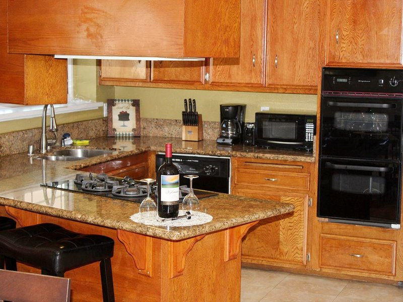 Granite counters - Knives, pots, coffee maker, toaster, and coffee supplied free
