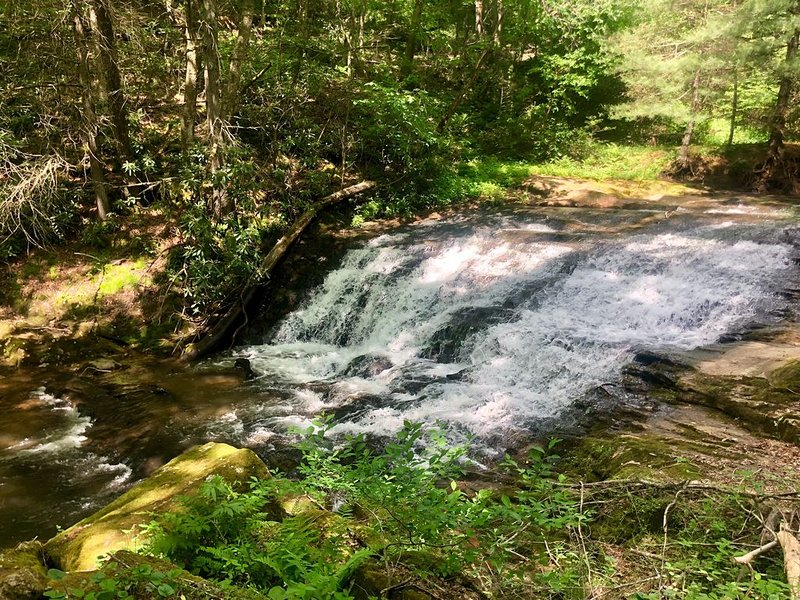 Waterfall at the base of our community you're welcome to walk to
