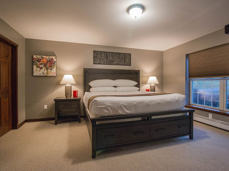 King bed. Hotel quality! Private bathroom. Huge 'smart' TV and front yard views.