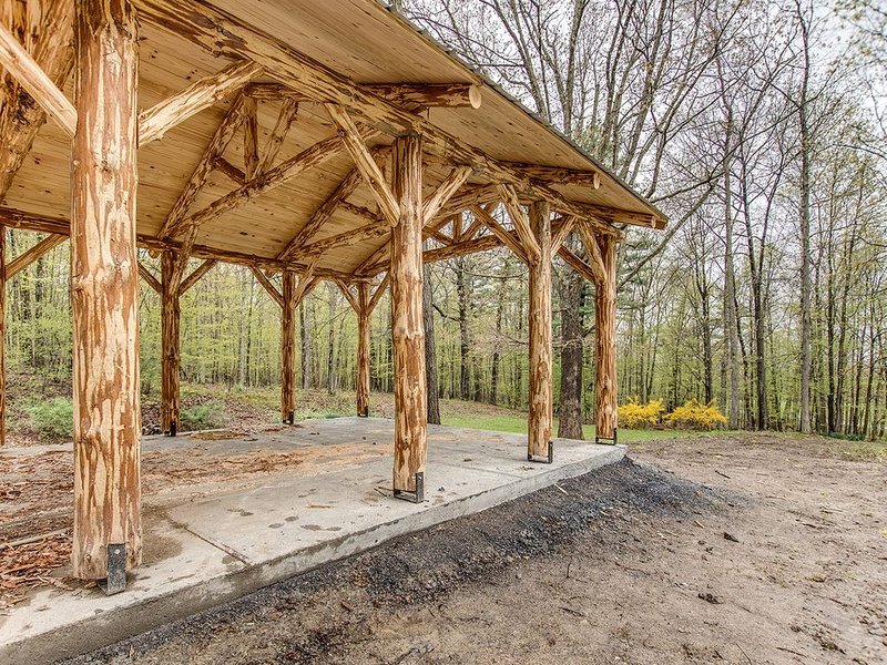 Pavilion built from handhewn log harvested in the woods. This has a firepit also