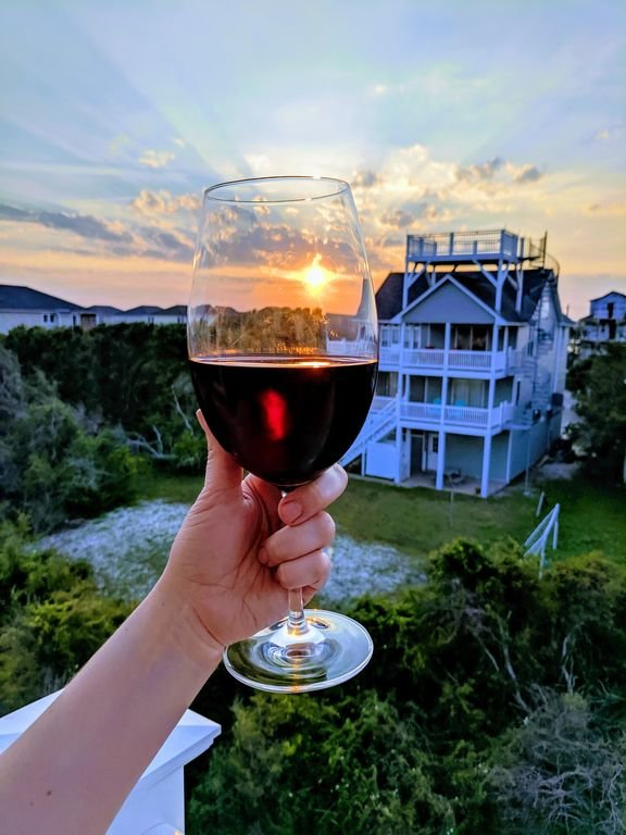 Enjoy a glass of wine on the back sunset deck! Cheers!