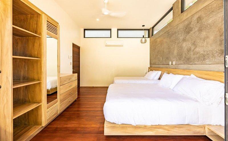 2nd ground floor bedroom has a Queen bed and Twin.