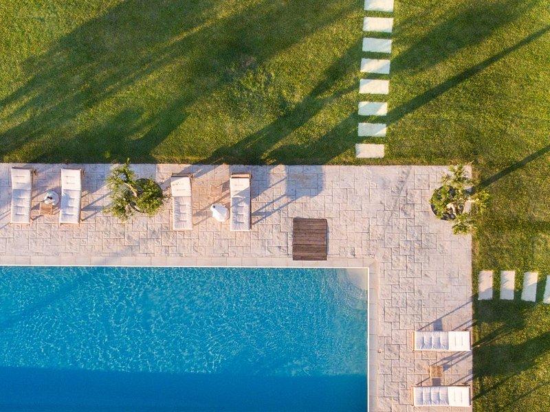 Amazing Beachfront Villa | Neapoli Villas, location de vacances à Velanidia