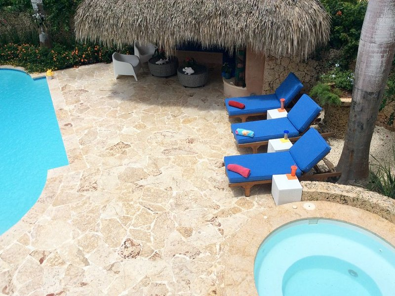 Shaded area-    Natural to the island coral stone pool deck-     hot tub for 10