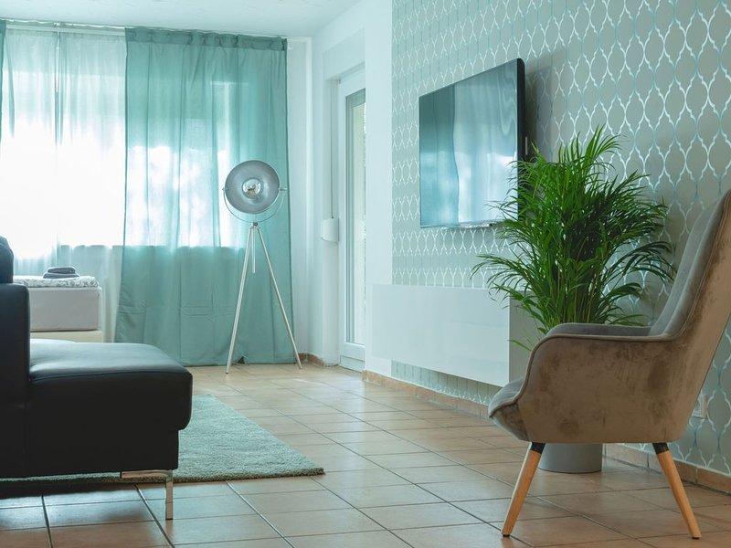 110 qm Wohnung mit Terrasse im Erdgeschoß - günstige Übernachtung, vacation rental in Kerpen