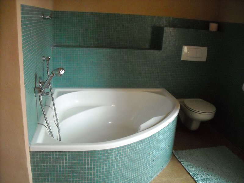 Bathroom upstairs, approximately12m2; shower, bath, washbasin, toilet.