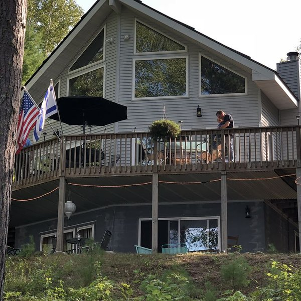 Walk out full basement Room with 3 beds and full private bath and fireplace., holiday rental in Munising