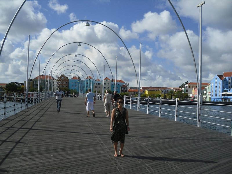 Downtown-Queen Emma Pontoon Bridge, pedestrian swing bridge rests on 16 pontoons