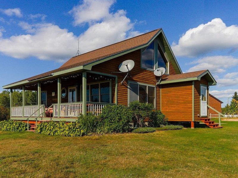 Cozy, dog-friendly, waterfront cabin w/ large yard, porch, dock, & lake views, holiday rental in Kokadjo