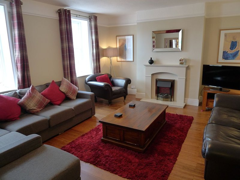 Front reception with comfortable seating, TV, DVD